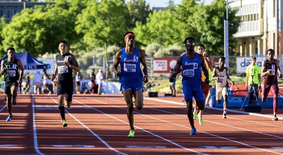 Men running; students