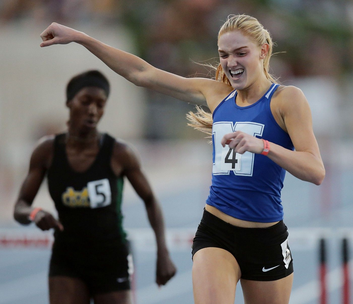 Female athlete racing; Track and Field